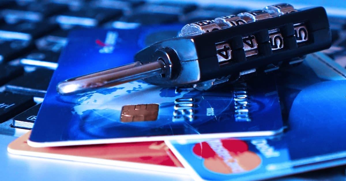 Image of a padlock, credit cards and a computer keyboard.