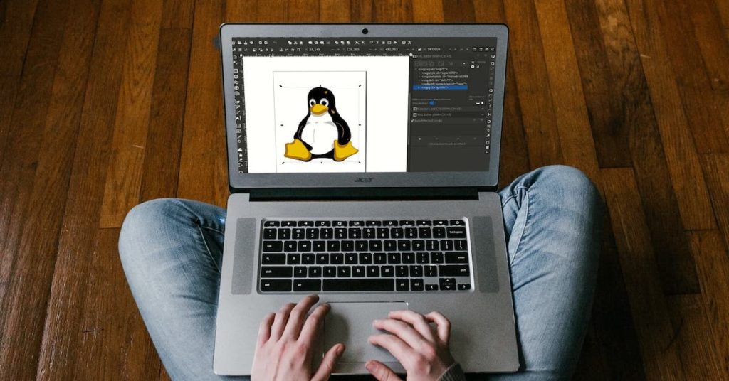 Image of a user designing a penguin cartoon on a laptop using Inscape software.