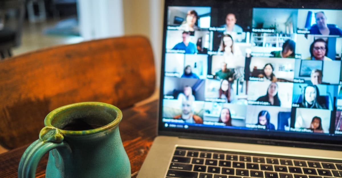 Image showing users in a zoom call on a macbook pro