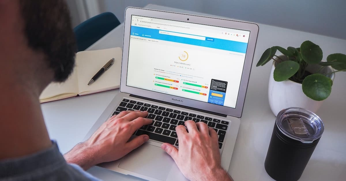Image of a user reviewing a website SEO score on a laptop