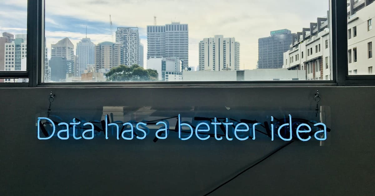 Images showing a city view from an office window with the text 'Data has a better idea' visible
